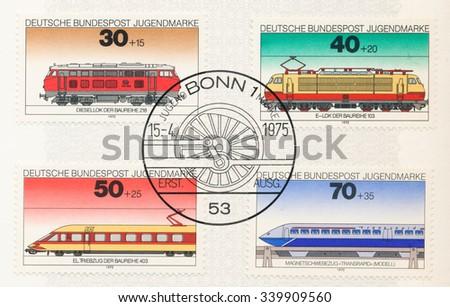 GERMANY - CIRCA 1975: A  postmark shows Locomotives: Diesel Locomotive Class 218, Electric engine Class 103, Electric rail motor train Class 403, Magnetic suspension train Transrapid, circa 1975 - stock photo