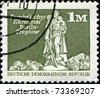GERMANY- CIRCA 1974: A stamp printed in GDR (East Germany) shows Soviet War Memorial, Berlin, Treptow, circa 1974 - stock photo