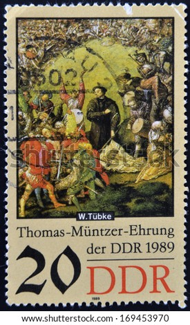 GERMANY - CIRCA 1989: a stamp printed in GDR shows Battle Scene, Detail of the Painting Early Bourgeois Revolution in Germany in 1525 by Werner Tubke, circa 1989  - stock photo