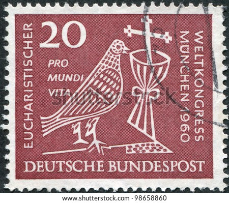 GERMANY - CIRCA 1960: A stamp printed in Germany, dedicated to 37th Eucharistic World Congress, Munich, depicted Dove, Chalice and Crucifix, circa 1960