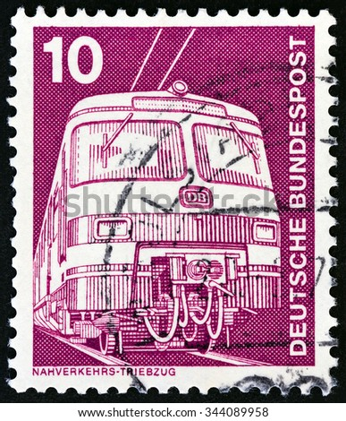 """GERMANY - CIRCA 1975: A stamp printed in Germany from the """"Industry and Technology"""" issue shows Electric train, circa 1975. - stock photo"""