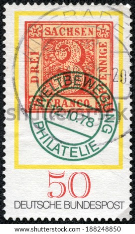 "GERMANY - CIRCA 1978: A stamp printed in Germany from the ""Stamp Day and World Philatelic Movement"" issue shows an old 3pf. stamp of Saxony from 1850, circa 1978. - stock photo"