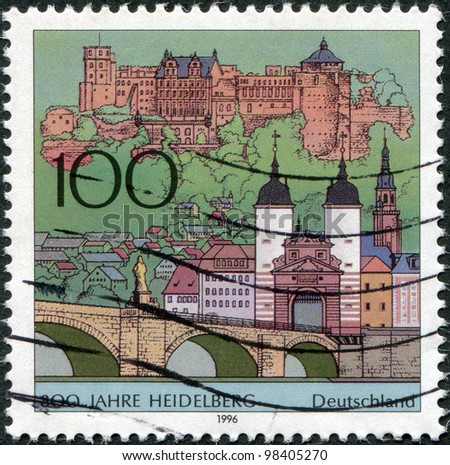 GERMANY - CIRCA 1996: A stamp printed in Germany, is dedicated to the 800th anniversary of Heidelberg, shows the old bridge to the city gates, the castle and the Church of the Holy Spirit, circa 1996 - stock photo