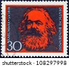 GERMANY - CIRCA 1968: A stamp printed in Germany issued for the 150th birth anniversary of Karl Marx shows Karl Marx, circa 1968. - stock photo