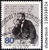 GERMANY - CIRCA 1985: A stamp printed in Germany issued for the 175th death anniversary of Fritz Reuter shows writer Fritz Reuter, circa 1985. - stock photo