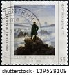 "GERMANY - CIRCA 2011: A stamp printed in Germany shows a picture of ""Wanderer above the Sea of Fog"" by Caspar David Friedrich, circa 2011 - stock photo"