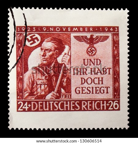 GERMANY - CIRCA 1943: A stamp printed in Germany, shows a soldier with a swastika flag, circa 1943