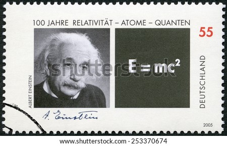 GERMANY - CIRCA 2005: A stamp printed in Germany shows Albert Einstein (1879-1955) and Equation of his Theory of Relativity, circa 2005 - stock photo