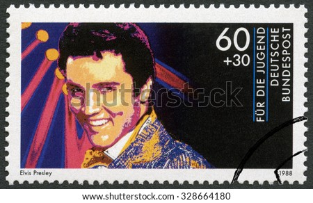 GERMANY - CIRCA 1988: A stamp printed in Germany shows Elvis Presley (1935-1977), series Rock Stars, circa 1988 - stock photo