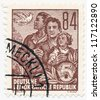 GERMANY - CIRCA 1953: A stamp printed in Germany, shows family and pigeon, series Five year plan, circa 1953 - stock photo