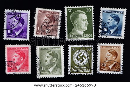 GERMANY - CIRCA 1943: A stamp printed in Germany shows image of Adolf Hitler was an Austrian-born German politician and the leader of the Nazi Party, in green, circa 1943. - stock photo