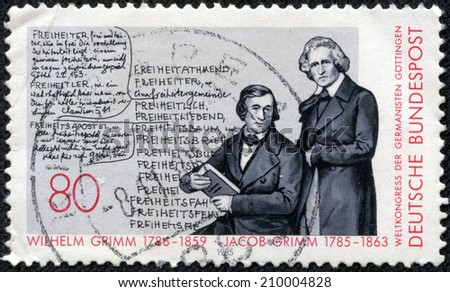 GERMANY - CIRCA 1985: A stamp printed in Germany shows portrait brothers Wilhelm (1786-1859) and Jacob (1785-1863) Grimm, Deutches Worterbuch, circa 1985 - stock photo