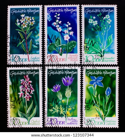 GERMANY - CIRCA 1965: A stamp printed in Germany shows six kinds of colorful flowers, circa 1965. - stock photo