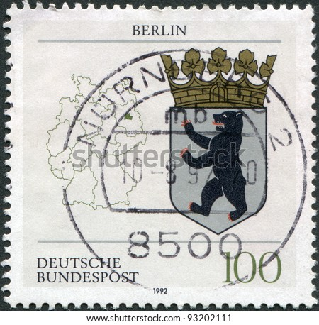 GERMANY - CIRCA 1992: A stamp printed in Germany, shows the coat of arms of the federal state of Berlin and the map of Germany, circa 1992
