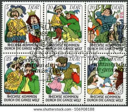 "GERMANY - CIRCA 1977: A stamp printed in Germany shows Various scenes from fairytale: ""Six Men Around the World"", circa 1977"