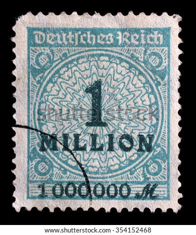 GERMANY - CIRCA 1932: A stamp printed in the Federal Republic of Germany shows image of hyper inflated numbers, series, circa 1932 - stock photo