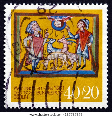 GERMANY - CIRCA 1980: a stamp printed in the Germany, Berlin shows Annunciation to the Shepherds, from Altomunster Manuscript, 12th Century, Christmas, circa 1980