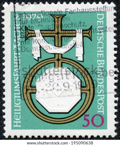 GERMANY - CIRCA 1979: A stamp printed in the Germany, dedicated to the pilgrimage to Aachen, shows Cross and Charlemagne's Emblem, circa 1979 - stock photo