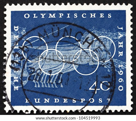 GERMANY - CIRCA 1960: A stamp printed in the Germany shows Chariot Race, Sport Scene from Greek Urn, 17th Olympic Games, Rome, circa 1960