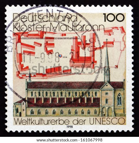GERMANY - CIRCA 1998: a stamp printed in the Germany shows Cistercian Monastery Maulbronn, UNESCO World Heritage Site, circa 1998 - stock photo