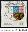 GERMANY - CIRCA 1994: a stamp printed in the Germany shows Coat of Arms of Saar, State of the Federal Republic of Germany, circa 1994 - stock photo