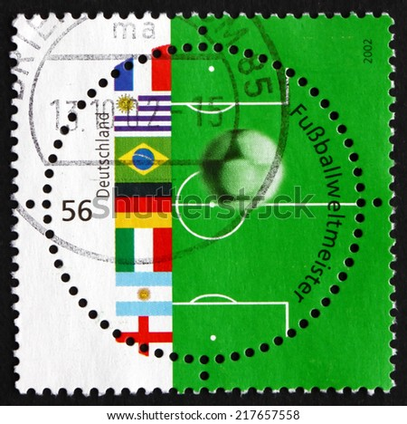 GERMANY - CIRCA 2002: a stamp printed in the Germany shows Flags, Soccer Ball and Field, 2002 World Cup Soccer Championships, Japan and Korea, circa 2002 - stock photo