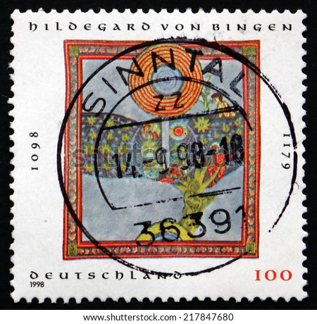 GERMANY - CIRCA 1998: a stamp printed in the Germany shows Hildegard von Bingen, Benedictine Nun, Mystic and Writer, circa 1998 - stock photo