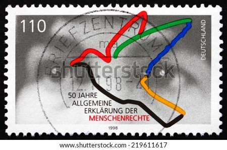 GERMANY - CIRCA 1998: a stamp printed in the Germany shows Human Eyes and Dove, Universal Declaration of Human Rights, 50th Anniversary, circa 1998