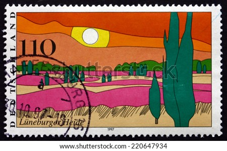 GERMANY - CIRCA 1997: a stamp printed in the Germany shows Luneburg Heath, large area of heath, geest and woodland in northern Germany, Scenic Region, circa 1997 - stock photo