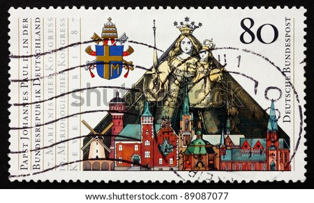 GERMANY - CIRCA 1987: A stamp printed in the Germany shows Papal Arms, Madonna and Child and Buildings in Kevelaer, State visit of Pope John Paul II, circa 1987
