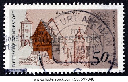 GERMANY - CIRCA 1975: a stamp printed in the Germany shows Plonlein Corner, Siebers Tower and Kobolzeller Gate, Rothenburg, European Architectural Heritage Year, circa 1975