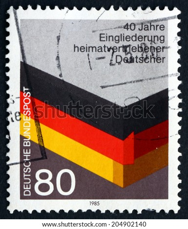 GERMANY - CIRCA 1985: a stamp printed in the Germany shows Reintegration of German World War II Refugees, 40th Anniversary, circa 1985 - stock photo
