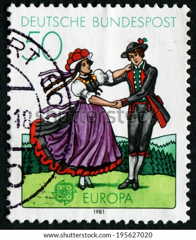 GERMANY - CIRCA 1981: a stamp printed in the Germany shows South German couple dancing in regional costumes, circa 1981 - stock photo