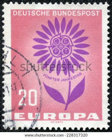 GERMANY - CIRCA 1964: a stamp printed in the Germany shows Symbolic Daisy, 5th Anniversary of CEPT, 22 Petals Symbolize 22 Members of the Conference, circa 1964 - stock photo