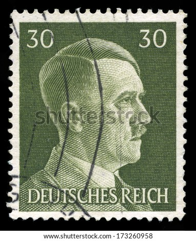 GERMANY - CIRCA 1945: A vintage German Reich Postage Stamp portraying an image Adolf Hitler, circa 1945. - stock photo