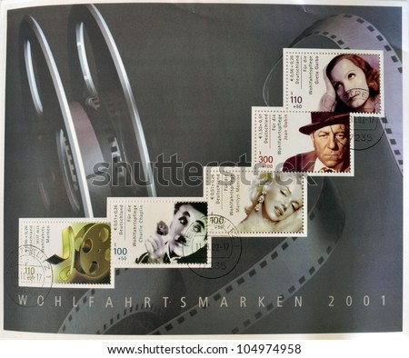 GERMANY - CIRCA 2001: Collection stamps printed in Germany dedicated to cinema, shows Greta Garbo, Marilyn Monroe, Charles Chaplin and roll of film, circa 2001 - stock photo