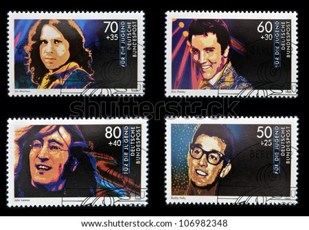 GERMANY - CIRCA 1988: Collection stamps printed in Germany dedicated to rock and roll, shows John Lennon, Jim Morrison, Elvis Presley and Buddy Holly, circa 1988 - stock photo