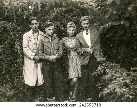 GERMANY, CIRCA FORTIES: Vintage photo of young people outdoor