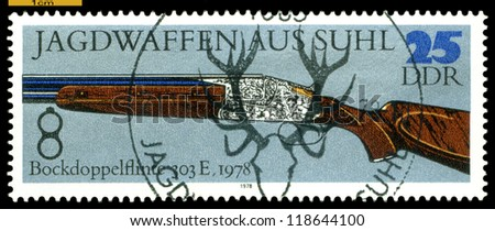 GERMANY - CIRCA 1978: post stamps printed in Germany,  shows  antique Superimposed  Double-Barreled  Gun. 1978. Hunting Guns series, circa 1978