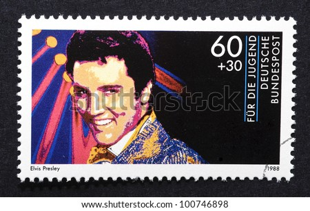 GERMANY  CIRCA 1988: postage stamp printed in Germany showing an image of Elvis Presley, circa 1988. - stock photo