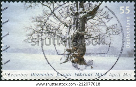 GERMANY - CIRCA 2006: Postage stamp printed in Germany, shows a winter landscape, circa 2006  - stock photo