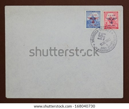 GERMANY, CIRCA 1942: real envelope from World War II with stamps with Nazi eagle symbol and postmark with swastika, Germany, circa 1942  - stock photo