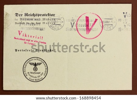 GERMANY, CIRCA 1941: real envelope from World War II with stamps with Nazi eagle symbol and postmark with swastika, Germany, circa 1941  - stock photo