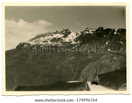 GERMANY -  CIRCA 1950s: An antique photo shows truck on the mountain road - stock photo