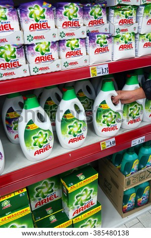 GERMANY - DECEMBER 21, 2015: Shelves filled with Ariel, a line of laundry detergents, in a Kaufland hypermarket. Ariel a detergents for clothes cleaning, is the flagship brand of Procter & Gamble. - stock photo