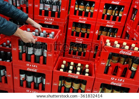 GERMANY - DECEMBER 21: Stack of crates Coca-Cola soft drinks bottles in a Kaufland Hypermarket. The Coca-Cola Company is an American multinational corporation. Taken on December 21, 2015 in Germany - stock photo