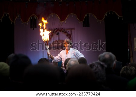 GERMANY, Esslingen am Neckar,  DEC. 06. 2014 :  A Magician of Fire Manipulation, will leave you Breathless as you watch his amazing skills at Christmas Market - stock photo