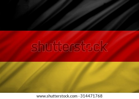Germany flag blowing in the wind. Background texture.