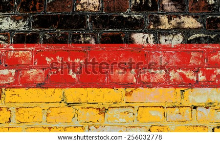Germany flag painted on old brick wall texture background - stock photo
