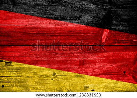 Germany flag painted on old wood plank background - stock photo
